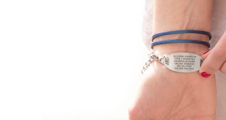 Woman wearing custom engraved diabetes bracelet with laser engraving